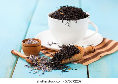 Tea leaves in a cup on a table. Selective focus. Copy space