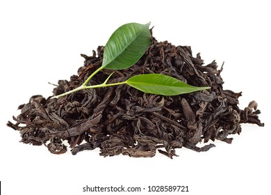 Tea leaves with dry black tea on a white background