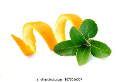 Tea leaves and orange zest isolated on white backgrounds. Green tea