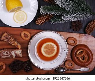 tea with lemon, drying, chocolate and Christmas tree branch
