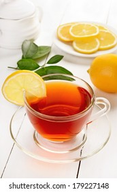 Tea with lemon on wooden table