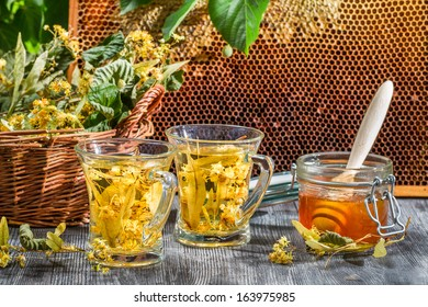 Tea made of lime and honey served in the garden