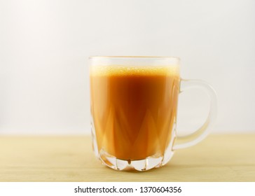 Tea with milk or popularly known as Teh Tarik isolated in white .