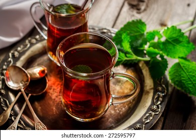 tea with mint in the Arab style on wooden table.Selective focus.
