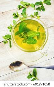 Tea with mint and lemon. Selective focus.