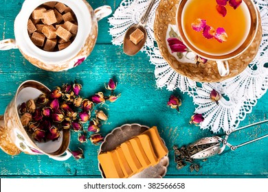 Tea in oriental style on a blue wooden background