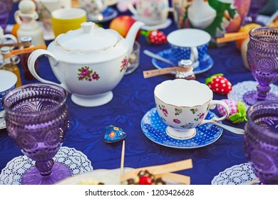 Tea party with cupcakes and different colorful cups