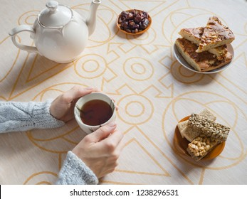 The tea party with pies in the home.