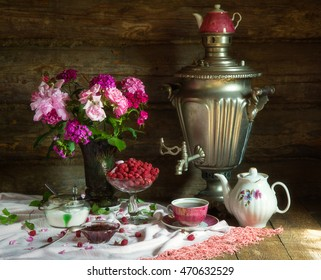 Tea Party in rustic style with samovar, raspberry and jam