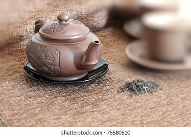 tea pot, cups  and green tea