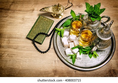 Tea pot with glasses. Oriental hospitality concept. Food and drink. Islamic holidays decoration. Vintage style toned picture