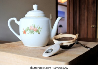 Tea pot on counter top in traditional English home kitchen.