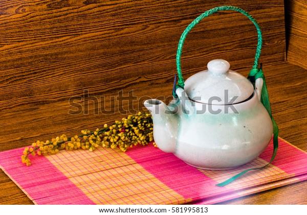 tea pot on wooden background still life art