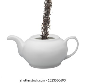 tea is poured into a white teapot isolated on white background