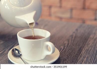 Tea pouring into glass