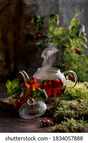 tea with rose hips in a glass teapot