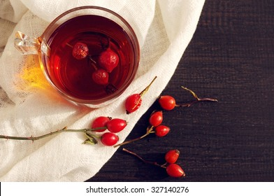 Tea with rosehip on a table. Useful drink for health. Herbal tea. Traditional medicine. Top view