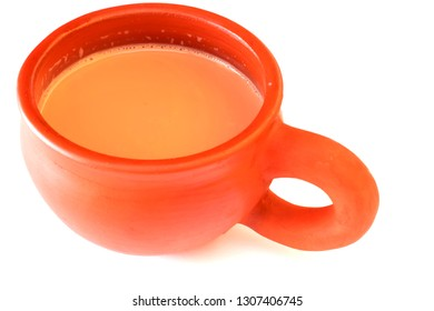 Tea served in a natural clay cup with background