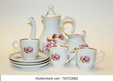 Tea service in white with a flower pattern. Sweetener, Milkmaid, cups and saucers.