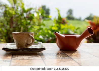 Tea set, tea cup and tea pour