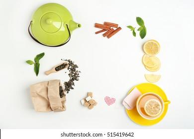 Tea set on white background, flat lay