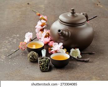 tea set (teapot, cups and different green tea)