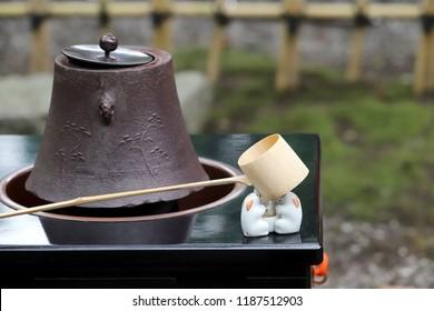 Tea set for traditional japanese green tea ceremony, iron pot, ladle, outdoors