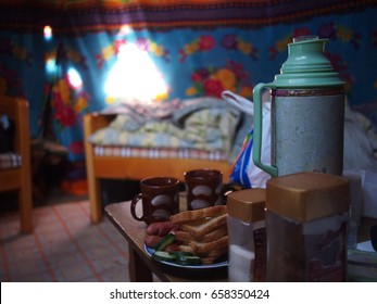 Tea and snacks inside a Mongolian ger