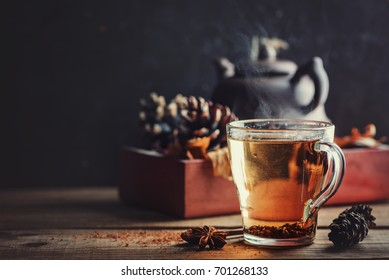 Tea with spices on a wooden background, rustic style, autumn postcard, copy space