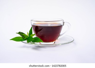 Tea time background. Hot black tea and hot steam generated in a cup. Drinking tea makes you feel fresh and healthy. A cup of tea on white background.