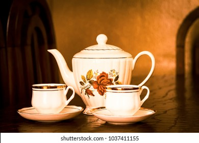 Tea Time: Beautiful teapot with two cups of tea.