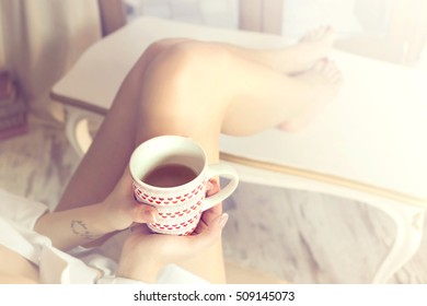 tea time, relaxed woman drinking a tea at home