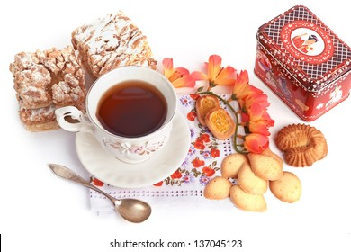 Tea Time. Still life with cup of tea and pastry.