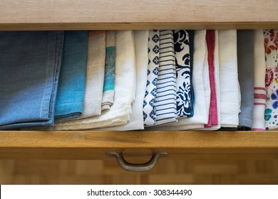 Tea towels smartly arranged in a drawer of dining table