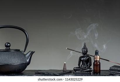 Tea tradition. Zen Concept. Massage, spa and relaxation. Still life on simple balck background