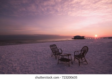 a tea for two in a snow beach at sunrise