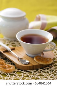 Tea in white porcelain cup and cookies