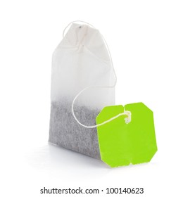 Teabag with green label. Isolated on white background