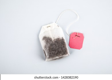 Teabag with pink label. Top view, on a white background. mockup