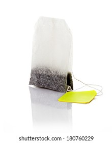 Teabag with yellow label isolated