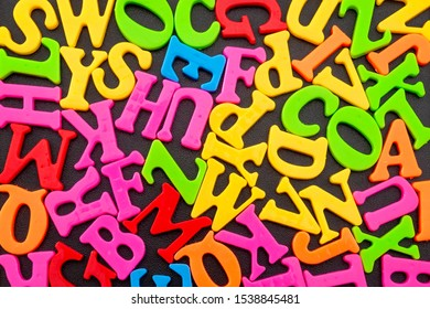 Teach the alphabet and educate conceptual idea with a big mess of different colour letters in word jumble