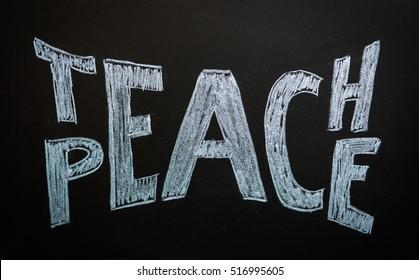 Teach peace written on a chalkboard. Peace concept