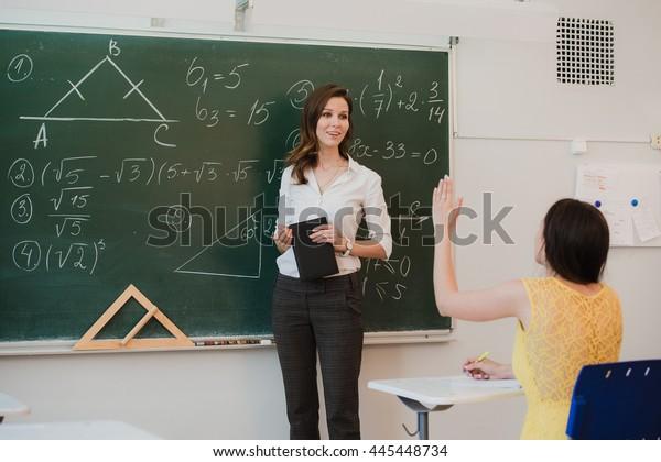 Teacher Answering Pupils Question Classroom Stock Photo ...