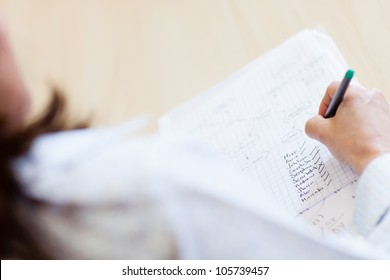 Teacher with attendance list ticking names of students