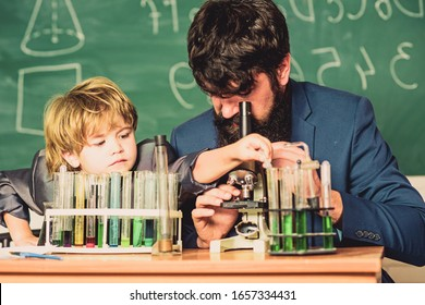 Teacher and boy in chemical laboratory. Study chemistry and biology. Studying is interesting. Personal example and inspiration. Study educational activity through experience. I love study in school.