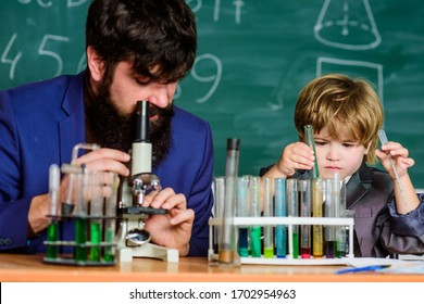 Teacher and boy in chemical laboratory. Study chemistry and biology. Personal example and inspiration. Studying is interesting. Study educational activity through experience. I love study in school.