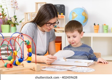 Teacher and Child Concentrated on Learning at Kindergarten Class