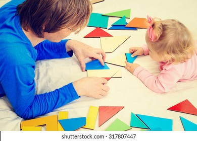 teacher and child playing with geometric shapes, early learning