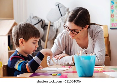 Teacher and child playing and learning at preschool classroom