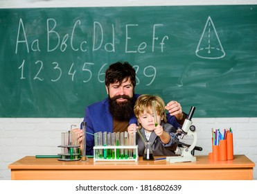 Teacher child test tubes. Chemical experiment. Genius minds. Signs your child could be gifted. Special and unique. Genius toddler private lesson. Genius kid. Joys and challenges raising gifted child.